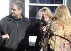 Relatives react outside Sandy Hook Elementary School following a shooting in Newtown