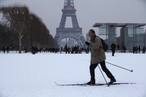 A man uses cross-country skis to make his way across the snow-covered Champs de Mars near the Eiffel Tower in Paris -0TTS2188.jpg-